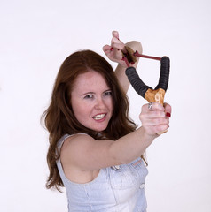 Young woman using a catapult