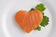 Heart shaped salmon on white plate - 65972639