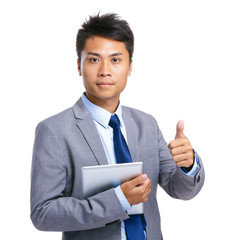 Business man with tablet and thumb up