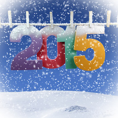Number 2015 hanging on a clothesline in a wintry background