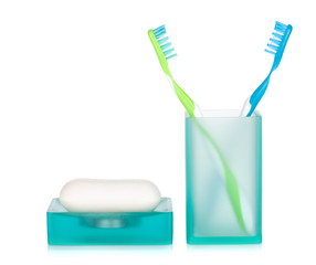 Two toothbrushes and soap