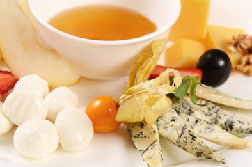 Assorted cheese with honey