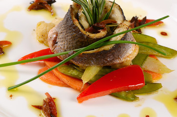 Sea bass fillet with spring vegetables