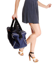 Woman's legs with bag.