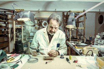 electronic engineer in the laboratory with a soldering iron