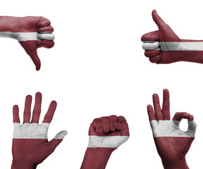 Hand set with the flag of Latvia