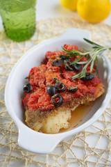 Baked cod under tomato sauce