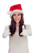 Attractive casual girl with Christmas hat saying Ok