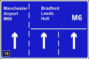Left hand lane of a motorway leads to another motorway sign