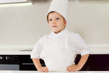 Proud confident boy in a chefs uniform
