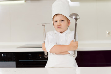 Young boy chef protecting his secret recipe