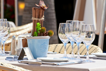 Beautiful table setting in a beach restaurant in Cannes, France