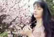 Brunette woman in spring flowers garden