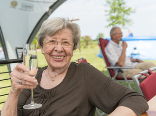 Senior Woman Outdoors in the Summer with Glass of Champagne