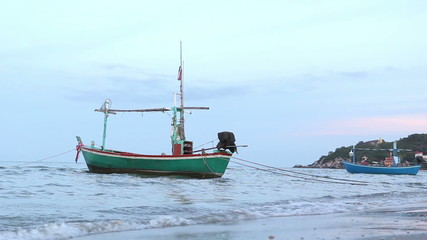 floating fisherman boat in the evening
