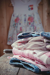 Still life with various girls clothes on an old wooden table