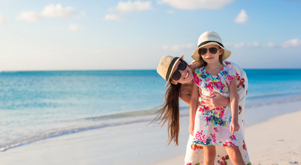 Portrait of mother and her adorable little girl enjoy summer