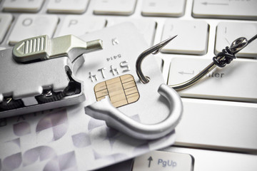 phishing - fish hook with a credit card and a broken lock