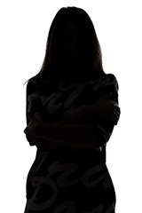 Silhouette of a woman in shadow