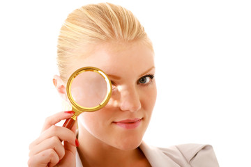 Young attractive smiling businesswoman looking into a magnifying