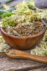 linden tea in a wooden bowl and scoop