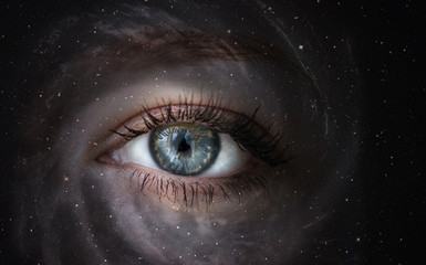Space galaxy with human eye. Concept image.