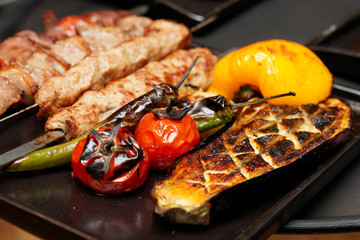 Meat and grilled vegetables