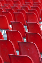 Red empty seats in stadium