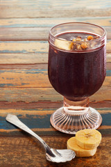 Acai in glass with banana on wooden table
