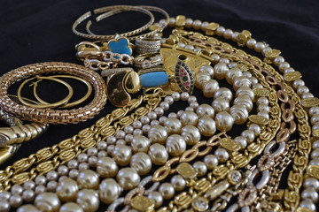 pirate's gold, variety of precious jewelry closeup, strong bokeh