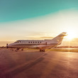 Business plane at airport during sunset
