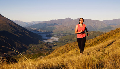 Woman Jogging In A Beautiful Mountain Scenic