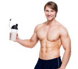 Young handsome bodybuilder with a bottle.