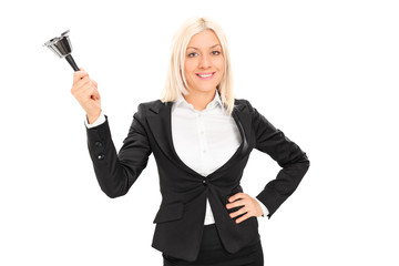 Woman in black suit ringing a lunch bell