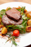 Steak with fried potatoes in plate