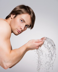 Man washing his face with water.