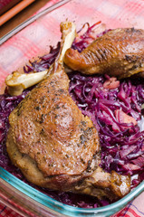 Goose legs baked on red cabbage