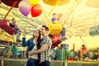 Young couple hugging in amusement park