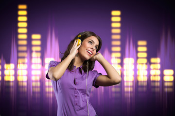 Happy girl with headphone listening to music