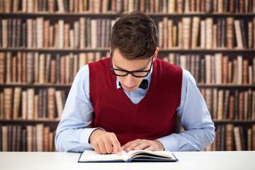 Focused student reading book