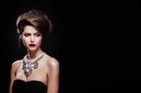beautiful woman with perfect makeup wearing jewelry - 65992688