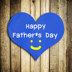Happy Father's day word on red heart shape with wooden wall