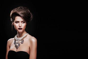beautiful woman with perfect makeup wearing jewelry