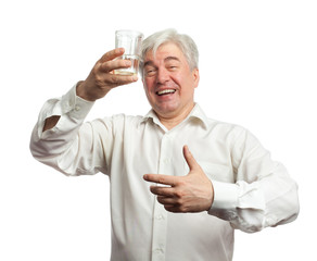 Man with a glass of vodka on a white background.