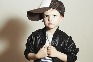 Fashionable Child. little boy in tracker Cap.fashion children