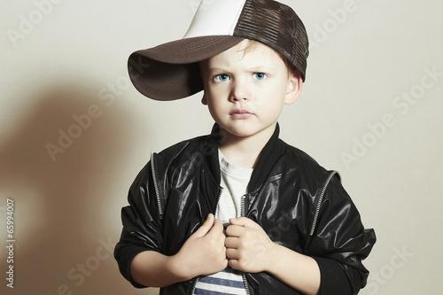 Fashionable Child. little boy in tracker Cap.fashion children