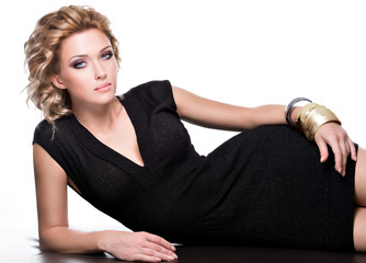 Glamour of a sensuality beautiful woman in black dress.