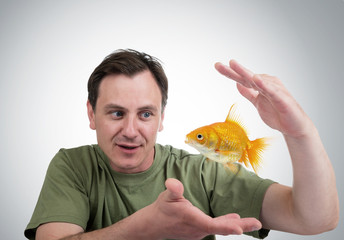 Surprised man with a goldfish