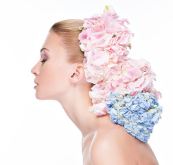 Profile portrait of young beautiful woman with  flowers