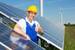 Photovoltaic engineer showing thumbs up at solar panel array - 65995815